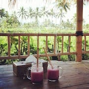 Enjoy a seasonal fruit juice watching the paddy fields
